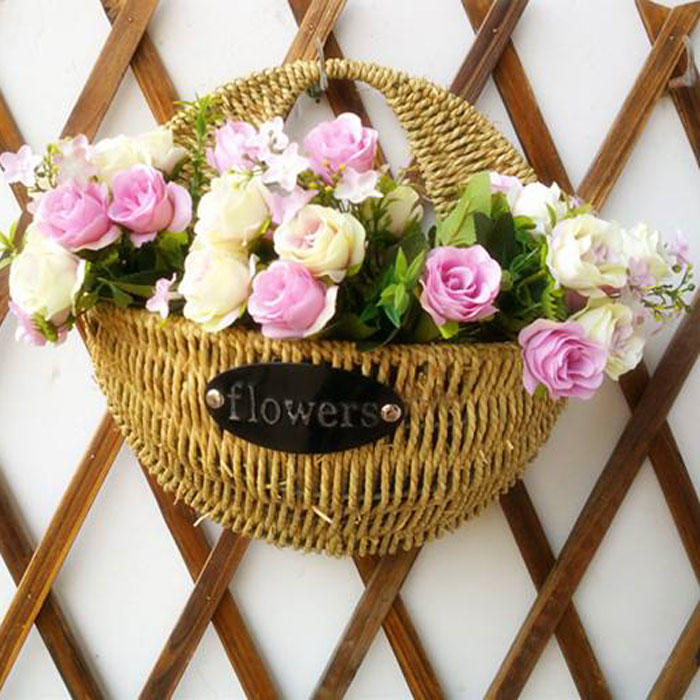 Art flowers basket made of hemp rope hang on the wall