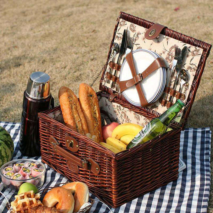 Hand weaving rattan picnic basket of family day